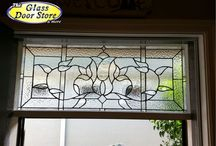 Stained glass transoms and windows / Stained glass panels in doors, windows, cabinets, and transoms. All handmade by stained glass artists