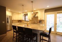 Wondrous in Wading River / This kitchen remodel is an open concept design.  Featuring subtle detailing on the cabinet doors, the modified shaker cabinets pair well with the Quarts counter top.  Bathed in light from many sources give a glow to the whole room day or night.