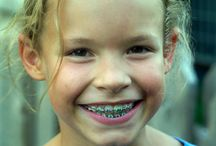Why Should You See An Orthodontist By Age 7? / While orthodontic treatment can benefit patients of all ages, including adults, it is always best for a child to receive his or her first orthodontic evaluation by the age of 7. While this may seem early, there is good reason for it. By the time the child reaches the age of 7, he/she has a good mix of baby and adult teeth. This allows Dr. Haney to detect subtle problems with jaw growth and developing adult teeth while some baby teeth are still present.