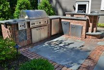 Outdoor Kitchen and Patio / Custom outdoor kitchen with bar and stainless steel appliances, built into patio design