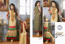 Mf Heena Khan / Superb Looking Designer Printed Georgette Straight Cut Salwar Suit en-crafted with beautiful embroidery work all over. Includes matching American Crape Bottom and Chiffon Duppatta.
