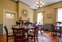 Private Dining / Your guests will feel like they have stepped back in time from the moment they enter our historic restaurant. Many of our elegantly decorated dining rooms date back to the early 1700′s and at the heart of 82 Queen is our mammoth Magnolia tree, surrounded by a turn-of-the-century courtyard. Explore our unique group dining spaces below.