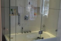 Glass Tub Enclosures / From frameless bathtub enclosures to glass tub enclosures with headrail, we'll help create a unique custom design that reflects your style. Showerman's timeless beauty of glass combined with our professional design creates frameless tub doors that are not only elegant, but also easy to maintain