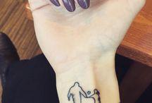 Tatuaggi su padre e figlia