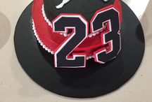 Jordan cake / Butter cream icing, using super red and super black gel food colouring from specialist cake shop. The symbol and numbers are made with fondant.  Always best to make fondant decorations at least 24 hrs beforehand so they set firm.