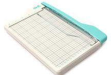 Mini Guillotine Cutter / Say hello to the Mini Guillotine Cutter! This handy little cutter is perfect for card making, planners, and other small projects. It features a ¼ inch grid for easy alignment and it cleanly cuts paper up to 8.5 inches. Its compact size makes it ideal for limited table space, like crops or events. It can cut 3 sheets of cardstock at one time. Coming to stores this summer!