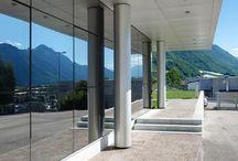 Adige Sala - Levico (TN) / Riqualificazione stabilimento produttivo. Facciata continua, rivestimenti e serramenti in alluminio