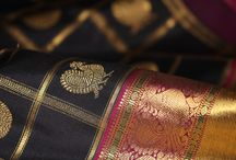 The Golden Aviary / Kanakavalli invites you into The Golden Aviary, a collective that celebrates bird motifs on the kanjivaram. Each motif is lovingly stylised and beautifully interpreted through the art of the weave, taking flight on the lush silk in gold zari. From the mythical 'annam', and the grace of the peacock ('mayil'), to the playful 'kili' or parrot, and the powerful 'iru thalai pakshi', a mythical two headed being, the traditional birds of the kanjivaram are distinctive and culturally significant motifs.