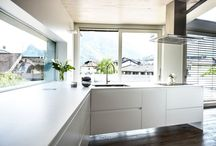 Contemporary white kitchen / Modern and contemporary white kitchen. Made with corian realized in corian and white lacquered. Design by Mangodesign.