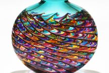 Michael Trimpol / Michael Trimpol Glass Artist was born in Philadelphia, PA, and started out in glass making while he was a student in Stowe, Vermont. Continuing his career in glass making whilst in attendance at Concordia University in Montreal, he worked on both public installations as well as residential commissions.