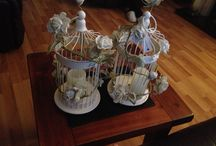 Bird cage wedding centrepiece idea / Cream bird cages, led candle and cream ivy