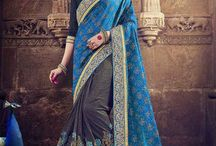 2676 Heritage 10 Wedding Saree / Indian women Present presents this blue and gray color saree. which exudes a lot of class and elegance. a must-have in your ethnic wear collection. look gorgeous at an upcoming wedding wearing the saree. featuring an attractive design on the border. this saree is made from two-tone jacquard and lycra fabric. Its attractive color and the designer stone, and zari heavy embroidered border and the skirt and designer work over the attire & contrast hemline adds to the look.