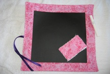 """""""Roll-up"""" Chalkboard Mat / Quiet time is easy when using our """"Roll Up"""" Chalk Board Mats. Cotton backed flexible chalk boards make it easy to store in your purse or any other small place so you have a quiet toy ready for any occasion. Includes Terry Cloth Eraser to wipe clean or just use water. / by Peek-a-Boo Covers (Car Seat Canopy)"""
