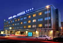 abba Huesca Hotel****S - Hotel in Huesca / 84 Rooms. Meeting rooms fro up to 450 people and 3,10 m. high. Lounge bar, Restaurant, Gym, Outdoor PooL and Car Park. Palacio de Congresos of Huesca (exhibition hall), the abba Huesca hotel is an excellent departure point to visit the Reino de los Mallos winery, the Parque Natural y Cañornes de la Sierra de Guara, the wine-cellars of D.O. del Somontano or the medieval villa of Alquezar. An area of outstanding natural beauty. / by Abba Hoteles