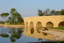 The Roman Arch / I had the opportunity to work with Boone Pickens and master builder Tommy Ford Construction on the Mesa Vista Ranch project that included a bridge and aqueduct, both supported by stone arch construction. The structural design was provided by Pete Hennessey, P.E. who recommended that the project use historic construction techniques that remain relevant today. The bridge and aqueduct are supported by stone arch construction, similar to those built in early civilizations.
