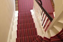 Stairs & Landings In A Red Multicoloured Striped Carpet / Client: Office In London. Brief: To supply and install wood flooring in a commercial premises. Result: Works completed within time and within budget.