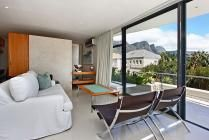 African Views Studio in Camps Bay / 4 Star! This comfortable apartment offers all the necessary modern amenities needed for a hassle-free holiday. Large sliding doors that open onto a wrap-around balcony and stunning mountain and sea views add a special touch.