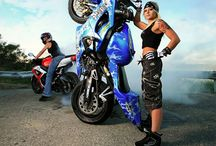 Female motorcycle stunt riders / Ladies who can ride a bike.