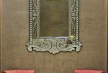 Mirror over armchairs