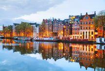 Olanda / Una terra strappata al mare, l'Olanda è un'incantevole tessitura di minuscoli paesini, ponti e canali, dighe e campagne smaglianti di fiori, fino ad Amsterdam, città vivacissima e magnifica.