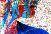 """Kunstaktion """"Graz-Stadtplan"""" 2011 / """"Meine Heimat ist Graz. Meine Heimat ist Kunst. Meine Heimat bin ich."""" In dieser Arbeit dient mein Körper sowohl als Kunstmedium als auch als Kunstobjekt. Die Farbwahl war beeinflusst von den vorgegebenen Farben des Stadtplans. Durch die Reaktion der einzelnen unverfälschten Farbschichten entstehen neue Farbnuancen. Somit entwickelt sich mein Stadtplan immer weiter und es entsteht eine eigene Sprache. Eine Fotodokumentation der Aktion soll meine Gedanken dazu nachempfindbar machen."""
