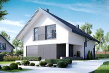 HomeKONCEPT 12 | Projekt domu / HomeKONCEPT-12 to dom, który łączy w sobie stylowy, nowoczesny wyraz z atrakcyjnym rozwiązaniem wnętrza. Dzięki prostej bryle i umiarkowanej powierzchni jest to ciekawa propozycja dla Inwestorów poszukujących projektu domu o niskich kosztach realizacji. Z zewnątrz ten dom wyróżnia oryginalna elewacja – biały tynk zestawiony z ciemnoszarymi płytami elewacyjnymi, tworzącymi na ścianach geometryczny podział.
