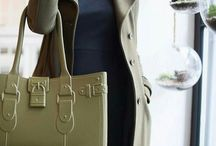 Model M. - PERIDOT (army green) / She's not just the 'it' bag of the season, she's a modern classic.  Fabricated of Fashion-Flex™—a proprietary polymer—Model M. withstands any fashion forecast. Model M. is stylish, resilient, light-weight, and patent-pending. The easy-to-wear construction gives the handbag a sculptural silhouette that never slouches. In sixteen vivid colors—Model M. is a head-turner, just like you.  #SwingOneToday! https://greatbag.co/collections/model-m-classic/products/model-m-peridot-pre-sale