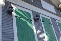 Shutters & yellow houses / Yellow houses with picket fences and shutters. Renovations being considered on a rental property.