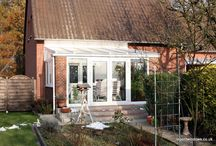 Germany 2005 / We were commissioned to supply and fit a conservatory in Europe and to incorporate traditional German tilt-and-turn windows. The French doors have side screens which means they can be opened to a full 180 degrees and held in place with cabin hooks.