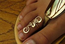 Toe Rings Hot & Sexy / Been on your feet all day at work? Just got back from that 5 mile hike or that 10k run?  Ladies ladies ladies, let's bless the foundation and adorn ourselves from the Tip to the Top.  Toe rings are trending from the festival goers to celebs, from Hollywood to Bollywood.  Let's explore the glam behind beautifying your feet with a little cultural accent. Check out these international flavors and see what fits your style the most.  / by ELAMENTS Design