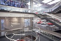 """Alfa Romeo Historical Museum - La Macchina del tempo / Alfa Romeo is celebrating its 105-year anniversary by opening its historical museum in Arese, Milan, Italy to the public; the museum is the heart of a genuine """"brand centre"""", and it hosts a bookshop, café, documentation centre, test drive track, events venues and a show-room with a customer delivery area: it is the perfect bond between past, present and future."""