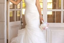 Trumpet designer wedding dress with asymmetrical organza pleats throughout bodice and skirt