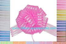 Pom Pom Pull Bows / Pom Pom Pull Bows | Honstar All of our bows are pre-made, self adhesive & easy to use.Just simply snip off a length of assembled ribbon and pull on the thin inner ribbon,and bows pulls up like magic!    www.ribbon-accessories.com/products/poly-bows/pom-pom-pull-bows/