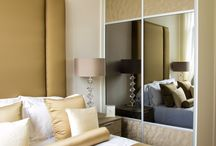 Sliding wardrobes / A beautiful addition to any bedroom which can be custom-built and bespoke to your taste. Different colour wood, glass, frosted, mirror and handles. All cut into the space - even the tightest corners, eaves and unusual shaped rooms.