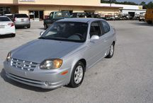 Used 2003 Hyundai Accent for Sale ($4,500) at Pinellas Park, FL / Make:  Hyundai, Model:  Accent, Year:  2003, Body Style:  Sedan, Exterior Color: Silver, Interior Color: Black,  Doors: Three Door, Mileage:68,000 mi, Engine: 4 Cylinder, Transmission: Automatic, Fuel: Gasoline.   Contact: 727-709-2145   Car ID (56694)