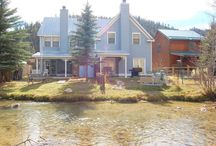 By the River / The outside of our home says Victorian but the inside houses a rustic combined with a country decor with a wood burning fireplace and an open floor plan. BY THE RIVER has had some really nice updates including a new tile floor that looks like real wood.