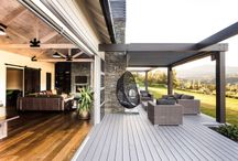 Rusticated weatherboard home / This home uses the traditional rusticated style weatherboard in a modern way off-set with a mix of stacked schist stone.