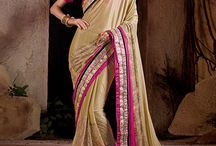 Latest Collection Of Wholesale Designer Sarees Collection / In ancient India, although women wore saris that bared the midriff, the Dharmasastra writers stated that women should be dressed such that the navel would never become visible.By which for some time the navel exposure became a taboo and the navel was concealed.