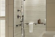 Kohler LuxStone Crushed Stone / Kohler LuxStone Shower Systems are made of a crushed stone and designed with stylish walls, clever accessories and convenient storage options.