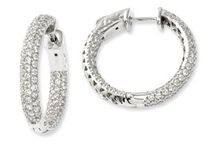 Silver Hoop Earrings / Sterling Silver Hoop Earrings From Gemologica. Let us help you find the perfect sterling silver hoops available with clear CZ gemstones and black CZ gemstones. Crafted of .925 sterling silver. Turn each of life's special moments into break-taking brilliance with Silver Hoop Earrings from Gemologica.