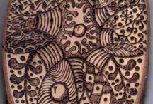 Tangling on wood, ceramics, porcelain, fabric, etc. / My works made on all other than paper surfaces.