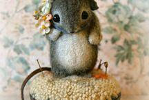 mice on  pin cushions