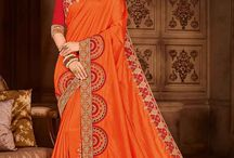 2678 MANGO 10 WEDDING WEAR SILK SAREE / All the Fashionable women will surely like to step out in style wearing this orange color two tone silk fabrics saree. this gorgeous saree featuring a beautiful mix of designs. look gorgeous at an upcoming any occasion wearing the saree. Its attractive color and designer embroidered design, patch design, stone, designer blouse, beautiful floral design work over the attire & contrast hemline adds to the look.