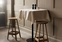 Albert / A sturdy piece of furniture with legs that widen toward the footrest. Albert is a refined version of the iconic English pub stool which inspired it.