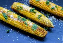 grilled corn with butter, parmesan and basil