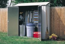 "Arrow Storage Locker / The Arrow Storage locker is designed to fit into the smallest of spots.  The 7' wide and 29"" deep foot print allows for this shed to be tucked in almost anywhere.  The shed comes with 4 shelves and a too hanging rack for added storage."