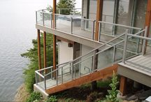 Contemporary Coastal Exterior / The exterior lighting, landscape and finishes of a home by the Pacific Ocean
