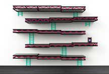 Donkey Kong Wall Furniture Design / So here is a Donkey Kong wall, strong, good looking but still has its character. The wall is made out of individual sections; each section is made out of durable but light carbon fiber, anodized aluminum pixels that are joined with strong stainless steel rods and toughened glass tops. The special mounts themselves are made out of steel and can support up to 60lbs