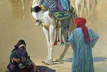 arabes en camellos