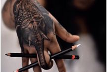 Left hand tattoos